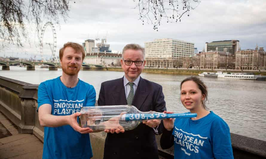 The environment secretary, Michael Gove, is handed a petition of more than 300,000 signatures calling for a bottle deposit return scheme.