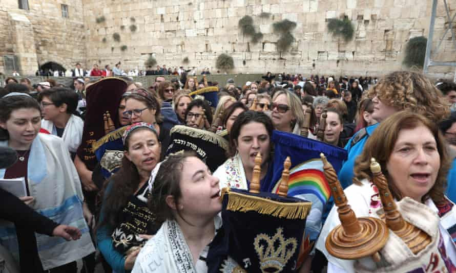 Members of the Women of the Wall carry a Torah scroll after prayers in the women's section of the Western Wall.