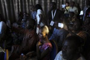 Guests watch the Festi'Bazin runway show in Bamako