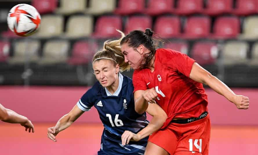 Team GB's Leah Williamson (left) and Canada's defender Vanessa Gilles contest a header.