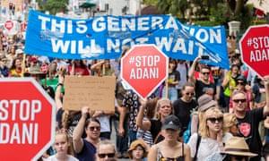 Marchers protest against Queensland's controversial Adani coalmine.