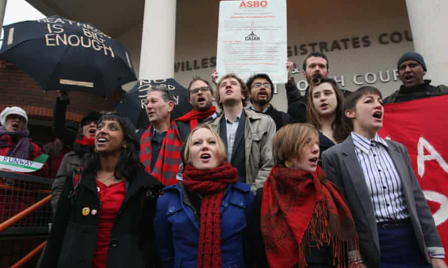 Members of the 'Plane Stupid' group gather on the steps outside Willesden youth magistrates court in January.