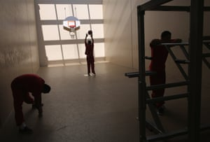 Detainees exercise at the Adelanto detention facility