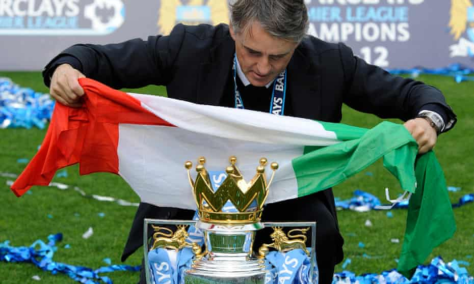 Roberto Mancini celebrates after leading Manchester City to the Premier League title in 2012.