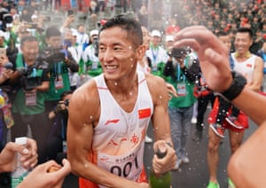 Pan Yucheng celebrates after the cross-country competition of military pentathlon at the seventh Military World Games