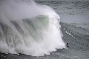 Surfer Justine Dupont rides a big wave.