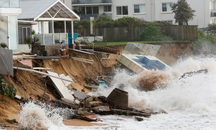 Waves crash against a swimming pool that was washed away from a property on the Collaroy beachfront after heavy storms battered Sydney's beaches.