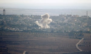 Smoke from explosions during fighting in the Syrian village of Jubata al-Khashab.
