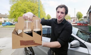 Richard Grainger owner of Graingers pub in Dublin delivers pints of Guinness