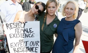 Comedian Amy Schumer (centre) protests against Brett Kavanaugh's nomination to the supreme court.