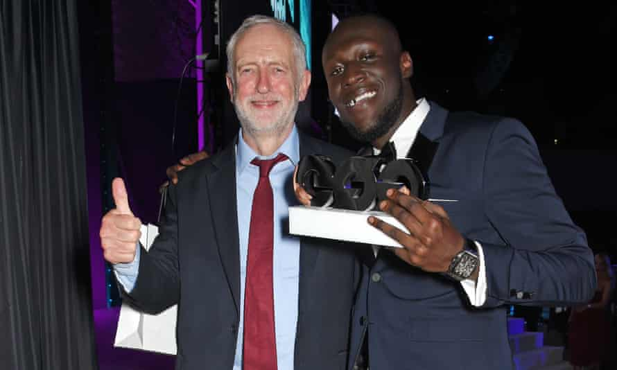 Stormzy poses at an awards ceremony with Jeremy Corbyn in 2017