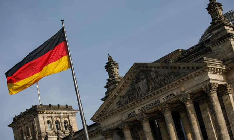 The German flag flys outside the Reichstag, the building which houses the Bundestag