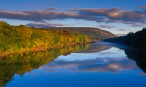 View of the Delaware river, Pennsylvania with autumn foliage and a deep blue sky.