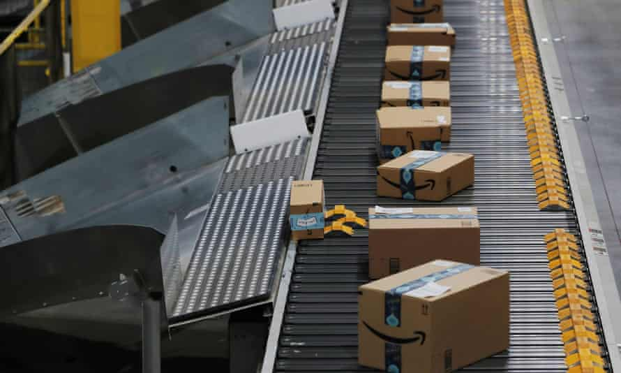 Amazon packages are pushed onto ramps