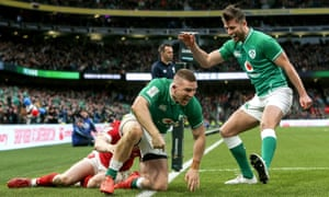 Andrew Conway roars with delight as Ross Byrne rushes to congratulate him for scoring Ireland's fourth try against Wales in their Six Nations win.