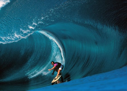 Riding giants: Laird Hamilton surfs Teahupoo in Tahiti.