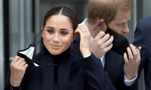 The Duchess of Sussex and Prince Harry, Duke of Sussex remove their protective face masks before posing for photographers in front of the World Tase Center in New York. The couple will attend the Global Citizen Concert in Central Park to stress the importance of global vaccine equity to end the pandemic.