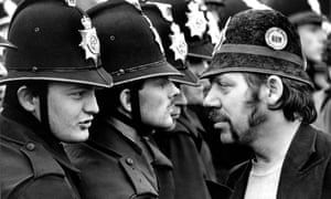 A striking miner faces a line of police at the Orgreave coking plant during the miners' strike, June 1984.