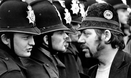 A striking miner faces a line of police at the Orgreave coking plant during the miners' strike in June 1984