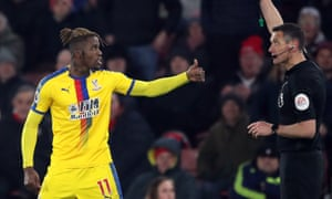 Crystal Palace's Wilfried Zaha with referee Andre Marriner.