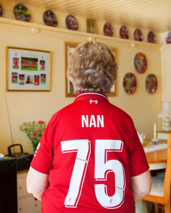 Liverpool fan with 'Nan 75' on back of shirt