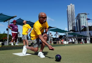 Jamaica's lawn bowls players Melvyn Edwards and Andrew Newell (behind in yellow) practice at the Southport Bowls Club in Gold Coast.