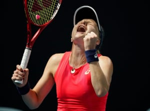 Harriet Dart celebrates after winning match point.