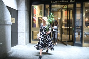 People exiting Deutsche Bank's Manhattan headquarters with some of their belongings today