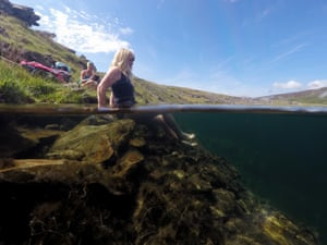 Jenny, left, and Vivienne prepare to brave the waters, in this image which shows writer and guest about to get into Llynnau Cwm Silyn