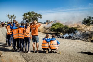 The Vattenfall Solar Team reacts to the NunaX solar car catching fire less than 250km from the finish line on the final day