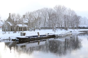 Barges on the river Barrow as snow falls in Athy, County Kildare.