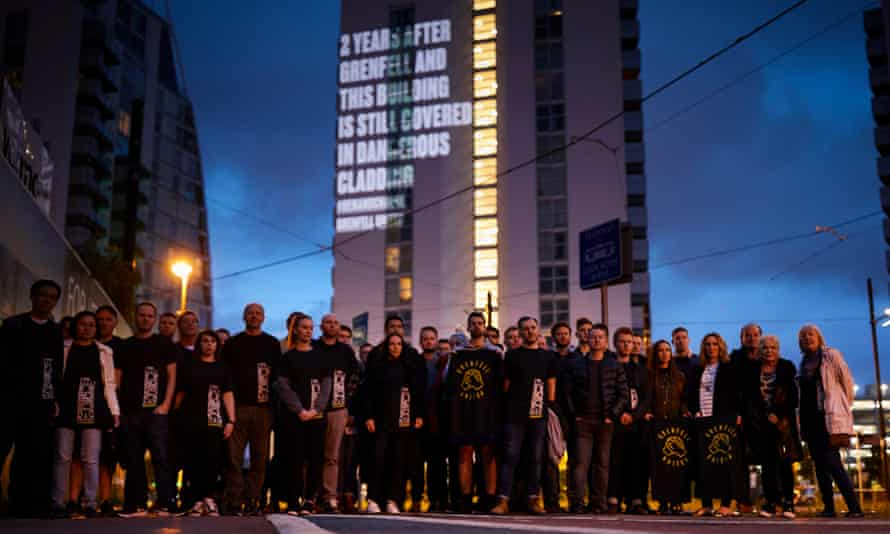 Residents gather outside NV Buildings, a block of luxury apartments at Salford Quays.