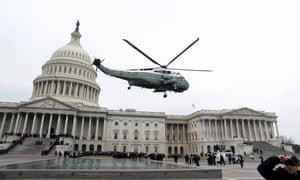 A military helicopter carries former president Barack Obama and Michelle Obama from the U.S. Capitol