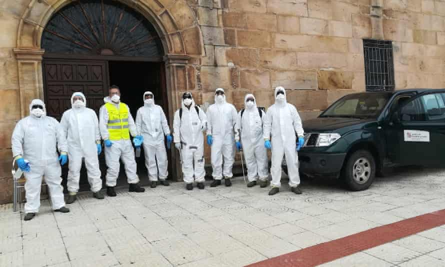 Volunteers in protective gear