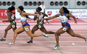 Asha Philip and Imani Lansiquot compete in the Women's 4x100m Relay heats.