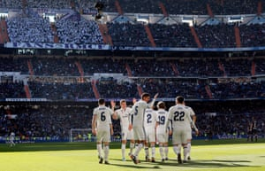 The Real Madrid players celebrate against Granada and the win puts them six points clear of Barcelona.
