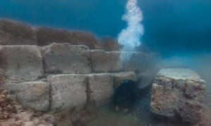 Underwater archaeologist Matej Školc carefully excavates the foundations of an ancient harbour structure.