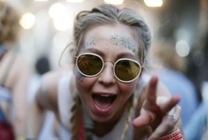 A festivalgoer dances as City Calm Down play on Sunday