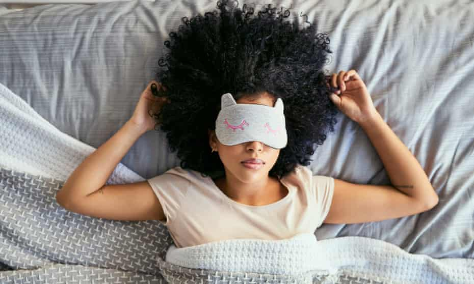 woman sleeping with a mask
