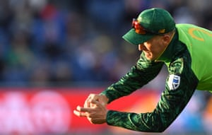 South Africa's Chris Morris takes a catch to dismiss Australia's David Warner.