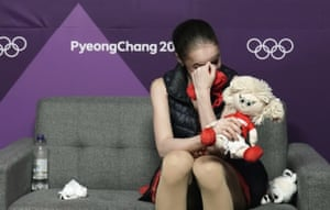 Alina Zagitova of the Olympic Athletes of Russia realises she has won the gold medal as she watches a television monitor in the green room.