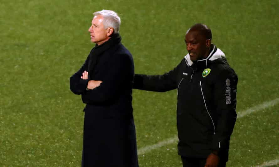 Den Haag's manager Alan Pardew (left) and his assistant, Chris Powell.