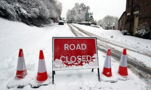 A road closed sign in snow covered Ironbridge in Shropshire.
