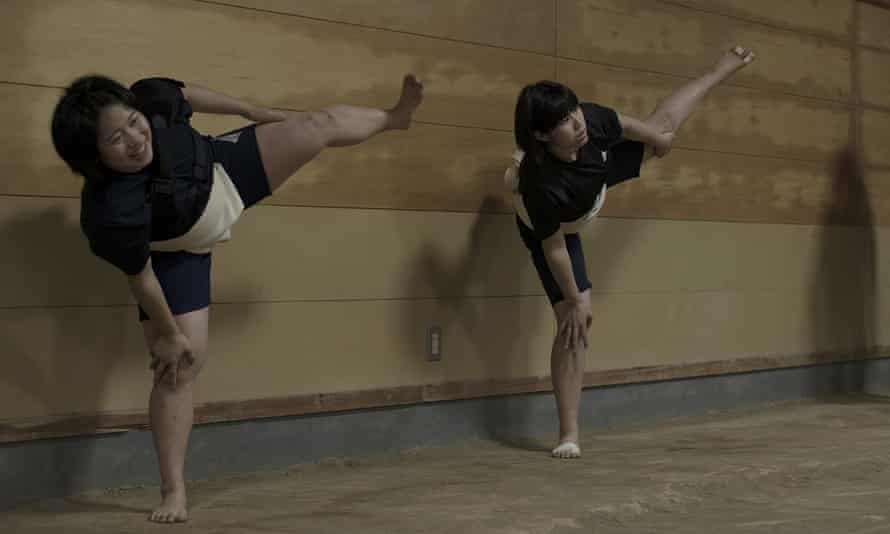 Two members of the Asahi University women sumo team go through their routine training, practicing Shiko, or foot stomping.