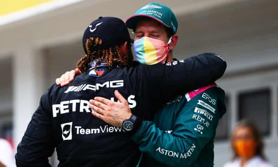 Lewis Hamilton and Sebastian Vettel embrace at the Hungarian Grand Prix on Sunday