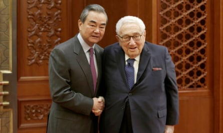 Chinese Foreign Minister Wang Yi shakes hands with former US Secretary of State Henry Kissinger at the Great Hall of the People in Beijing in November.