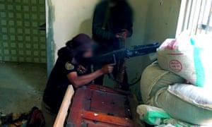 An al-Qaida in the Arabian Peninsula fighter using an MG3 machine gun in Taiz, south-west Yemen, in January 2016