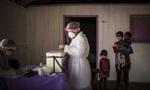 Health personnel perform coronavirus tests in the Bela Vista do Jaraqui community in the rural area of Manaus, Amazonas, Brazil, 30 May 2020.