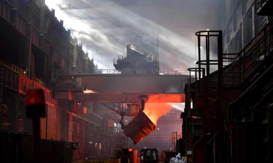Iron glows in a furnace at a mill belonging to German steelmaker Salzgitter