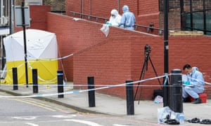 Forensic officers at the crime scene of a fatal stabbing at Roth Walk in Finsbury Park, north London